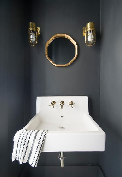 This Small Black And White Powder Room Features A Wall Mount Sink With A Polished Nickel Faucet Boldly Sta Black Powder Room Powder Room Small Powder Room Sink