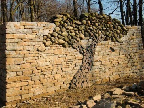 Awesome rock wall with decorative rock tree   Garden   Pinterest ...