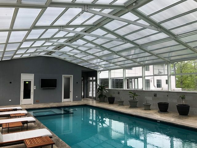 Residential Retractable Pool Enclosure South Brunswick Nj America S Leading Custom Manufacturer Of Retractable Enclosure And Roof Systems Pool Enclosures Retractable Pool Cover Roofing Systems
