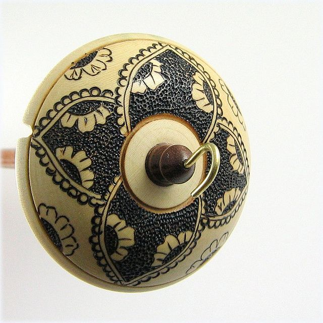 Holly and Walnut Top Whorl Drop Spindle with Pyrography by grizzlymountainarts, via Flickr