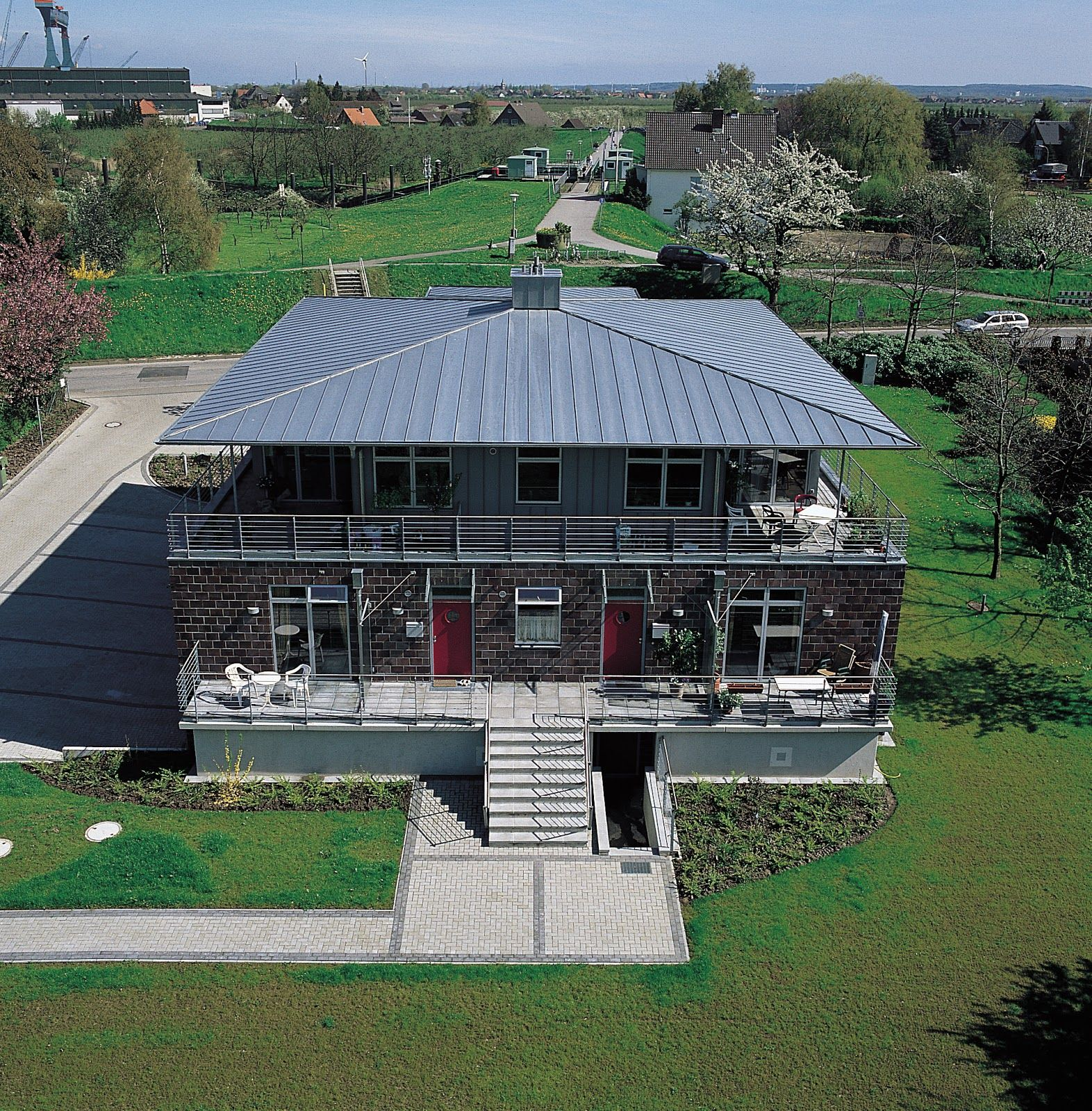 Home with a natural metal roof by VMZinc | Natural Metal