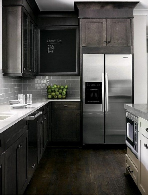 i love!!! dark black brown cabinets & stainless steel appliances w