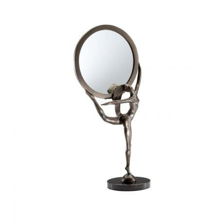 Caught in a lovely Art Deco Ballerina balancing pose, this artist designed Bronze Patina Ballet will give your vanity that finishing touch, and add a remarkable sense of understated chic to your home. An inspiring item to give as a gift also, that will be treasured for a life time!    Dimensions: 9.25-W x 20-H x 5.25-Ext.  Material / Finish: Bronze  Finish: Patina  Price: $170.00
