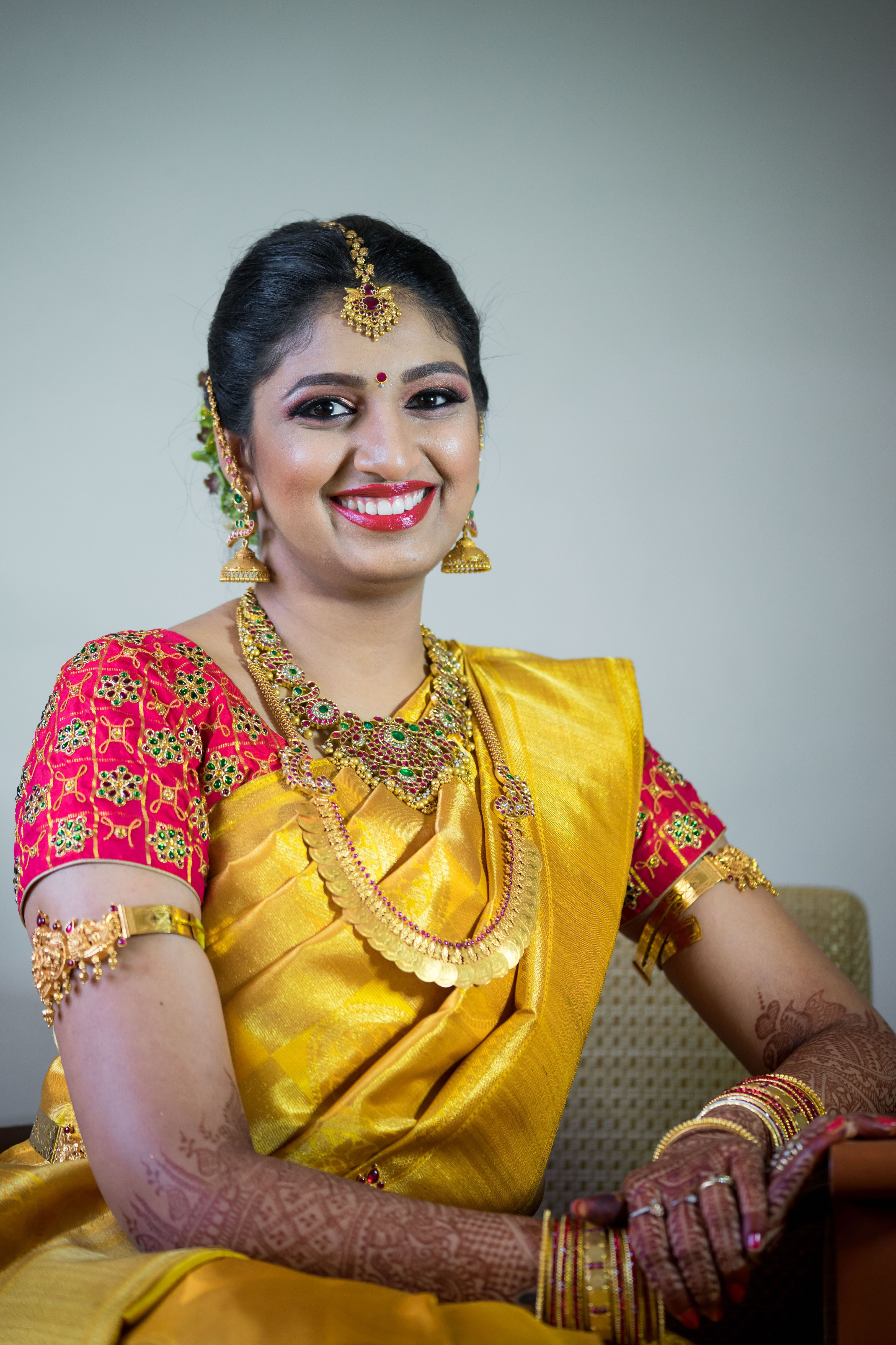 94fe875831f38 Swetha has paired a beautifully done Red blouse with Green work along with  her golden yellow saree! www.shopzters.com