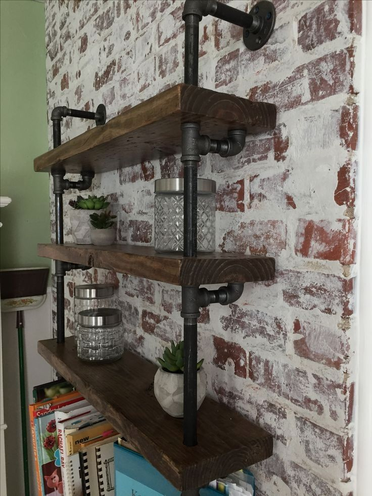 German Smear brick wall with industrial pipe shelving ...