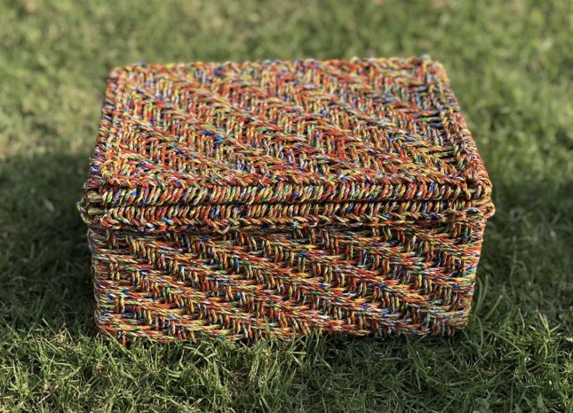The Little Bunting storage box is made from the wrappers of the infamous Indian snack Kurkure Masala Munch (a favourite). The wrappers were cleaned and tightented to ropes to form this sturdy box. Also available in the 'Dairy Milk' version. #wastetowow #wovenfurniture #vintagefurniture #charpoy #charpai #weaversofinstagram #sustainableliving #sustainabledesign #circulareconomy #circularfurniture #supportyourladies #surviveandthrive #sustainableliving #sustainablefurniture #circularfurniture #ski