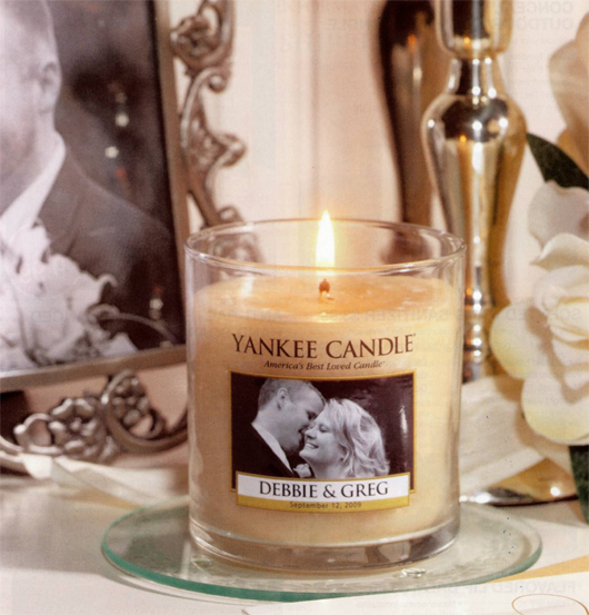 Yankee Candle makes customized candles for weddings! All you have to do is call and make an order. Cute Favor.. Love this idea!!!
