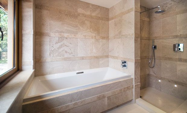 Wetroom Solutions by  GOSS Marble offer a completely  waterproofed floor, and walls  if required, with pre-machined  falls to drain and a surface that  is ready to be tiled. We can also  supply a full range of drains,  adhesives and accessories.