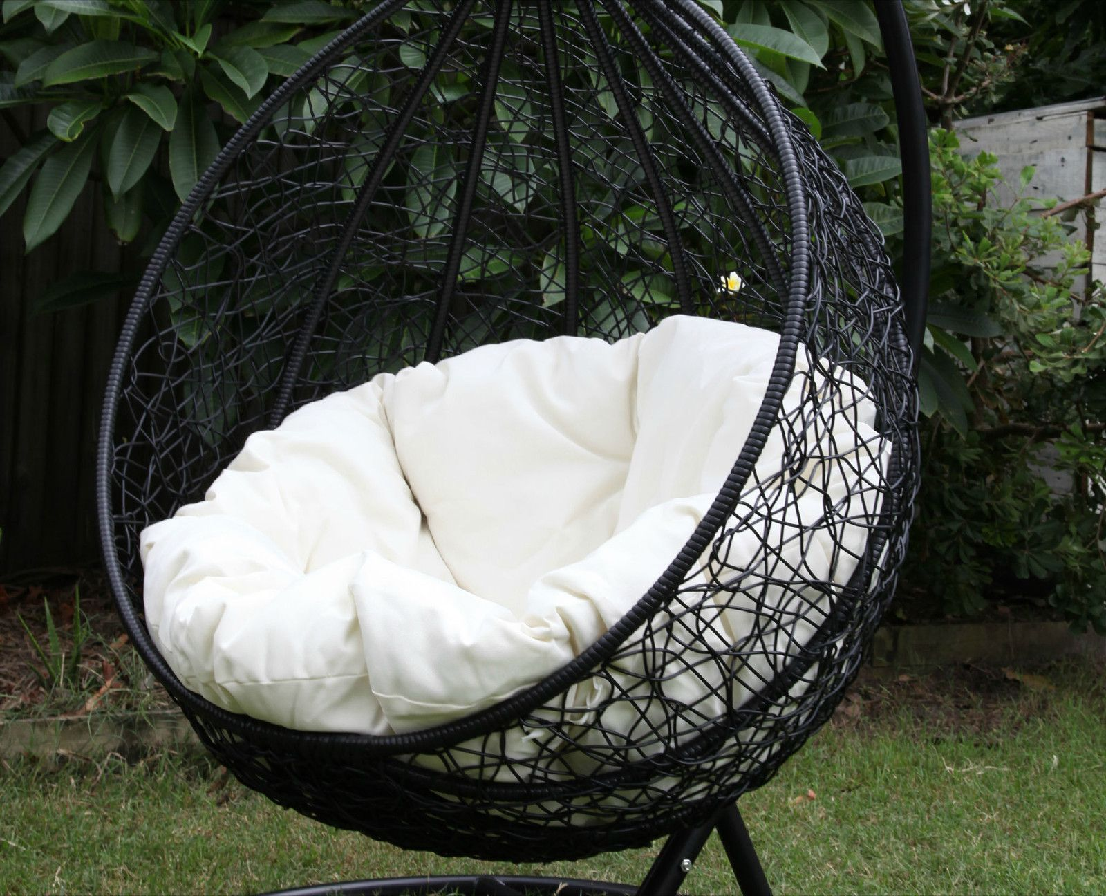 skycarte black hanging egg chair with white plush cushion and stand