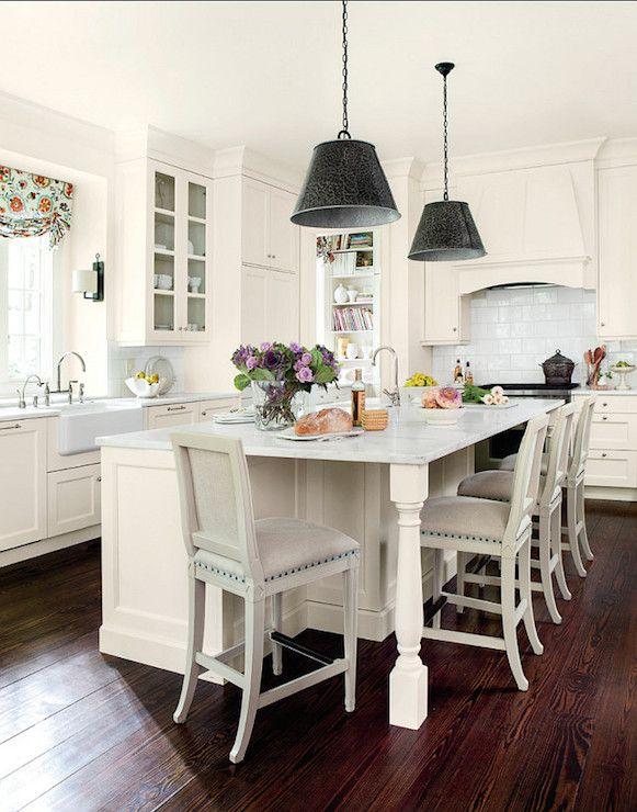 cottage chic white kitchen, dark hardwood floors, black pendants