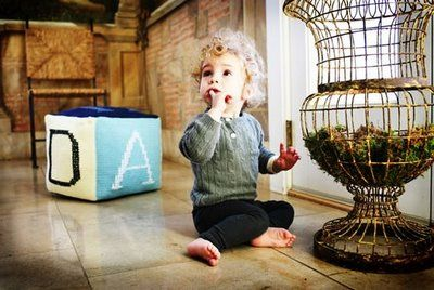 old campaign photo of my son with his fav anne-claire petit pouffe image by lindsay garvey photography