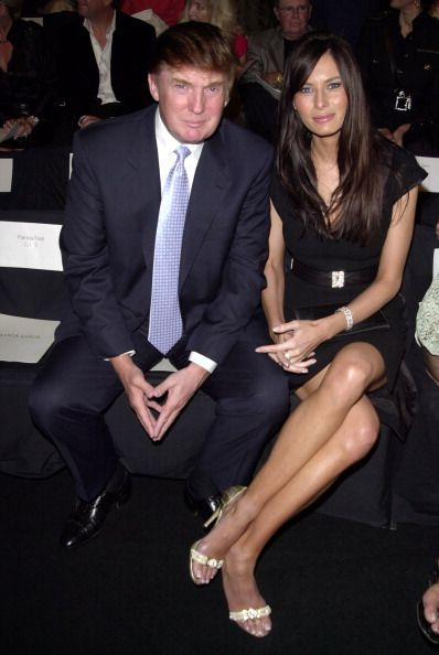 Donald Trump and Melania Knauss during MercedesBenz Fashion Week Spring 2004 Luca Luca Front Row and Back Stage at Gertrude Tent Bryant Park in New...