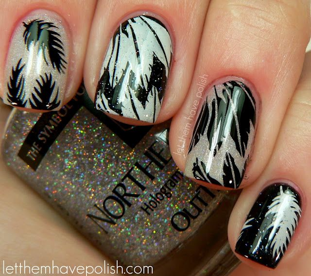 Bases of :Glitter Gal Light as a Feather and Zoya Raven.   Middle and Ring fingers: Bundle Monster plate BM214 and Black and White Konad Special polishes.   Index and Pinkie: Konad plate M77. topped off Pinkie and Middle Finger with some INM Northern Lights.
