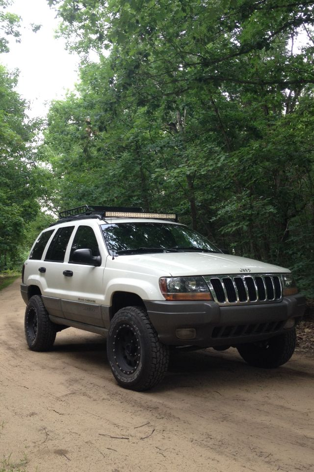 Jeep Grand Cherokee Wj Lifted 2 Light Bar Roof Rack Method Race Wheels Flow Master Jeep Grand Cherokee Jeep Wj Jeep Grand