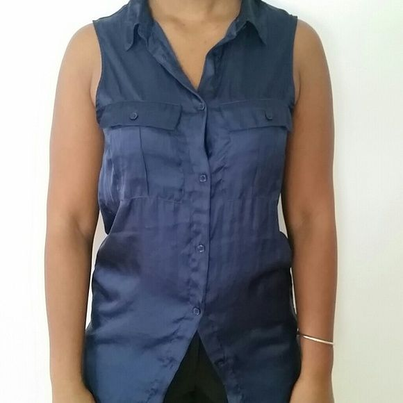 H&M dark blue extra long collared button up Pre worn. Too small for me.  Sleeveless.  High low hem.  Length in front 30 inches. Length in back 33 inches. Bust 17 inches. Two functional pockets in front. Satin look. 100% polyester. H&M Tops Button Down Shirts
