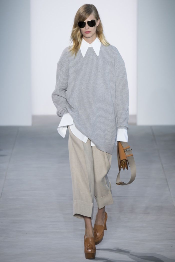 Michael Kors Spring 2017: Lexi Boling walks the runway in grey oversized sweater, white shirt and cropped pants