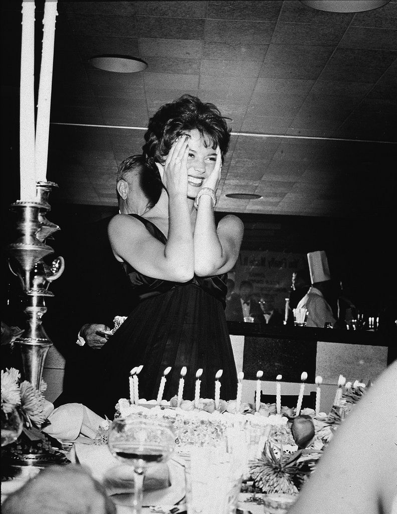 Pin by natalie on prom old hollywood pinterest - Natalie Wood Smiles And Holds Her Hands To Her Face Standing Behind Her Birthday Cake During Her Surprise Birthday Party At Romanoff S Hollywood