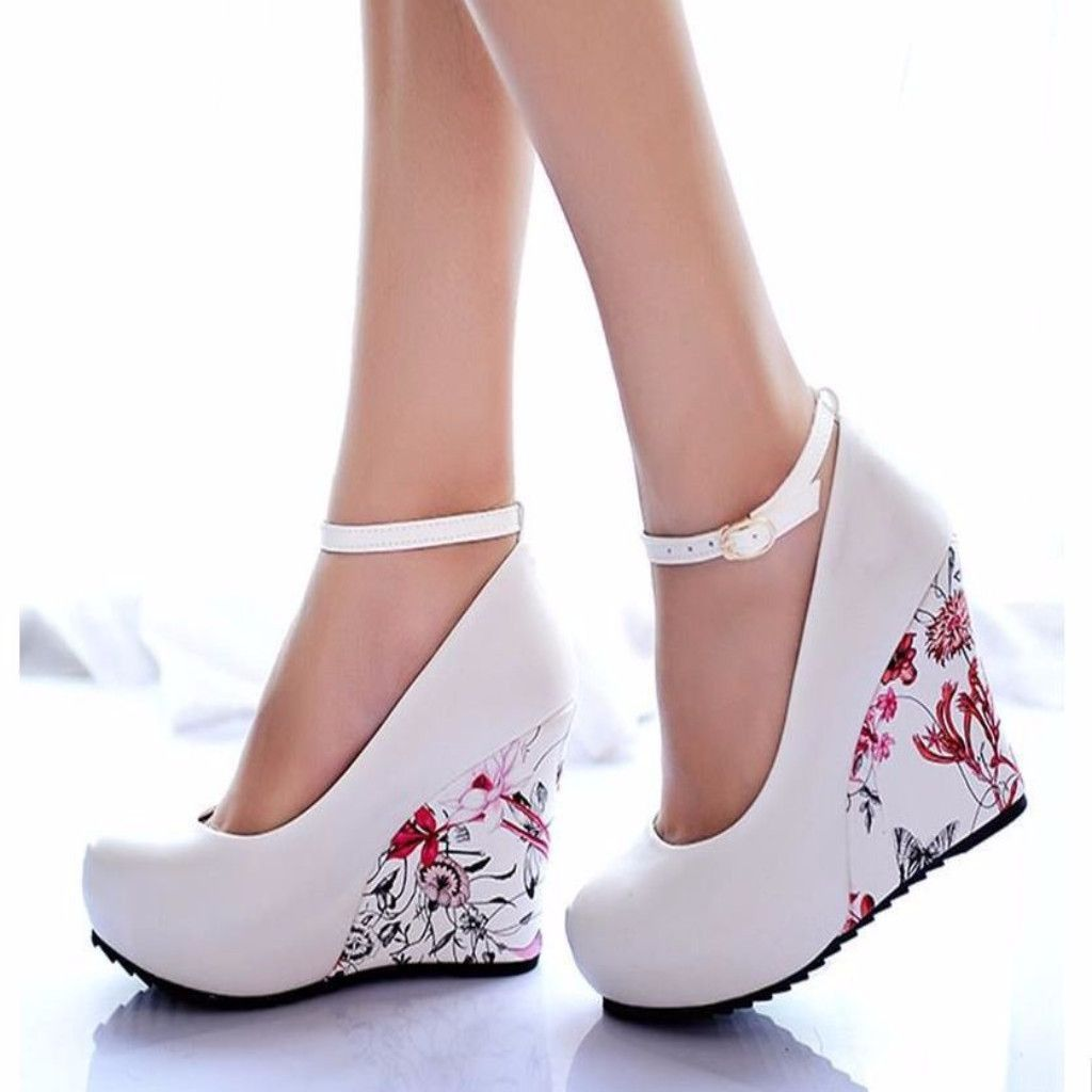 Have a greater heights using this floral wedge shoes. This features buckles  strap that fasten