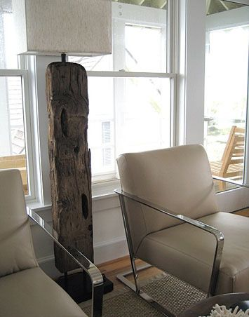 Modern rustic at its best: Sleek, chrome leather chairs,  wood beam floor lamp with rectangular shade.