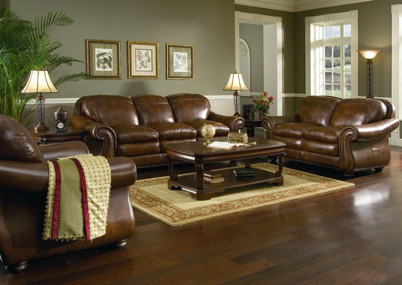 Brown and green living room - Brown Leather Sofa Set For Living Room With Dark Hardwood Floors