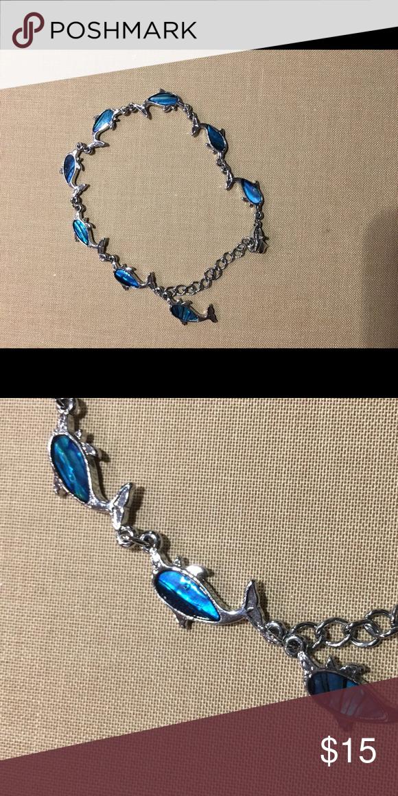 Blue and silver dolphin adjustable bracelet Blue and silver dolphin bracelet! Dolphins are made of shell. Jewelry Bracelets