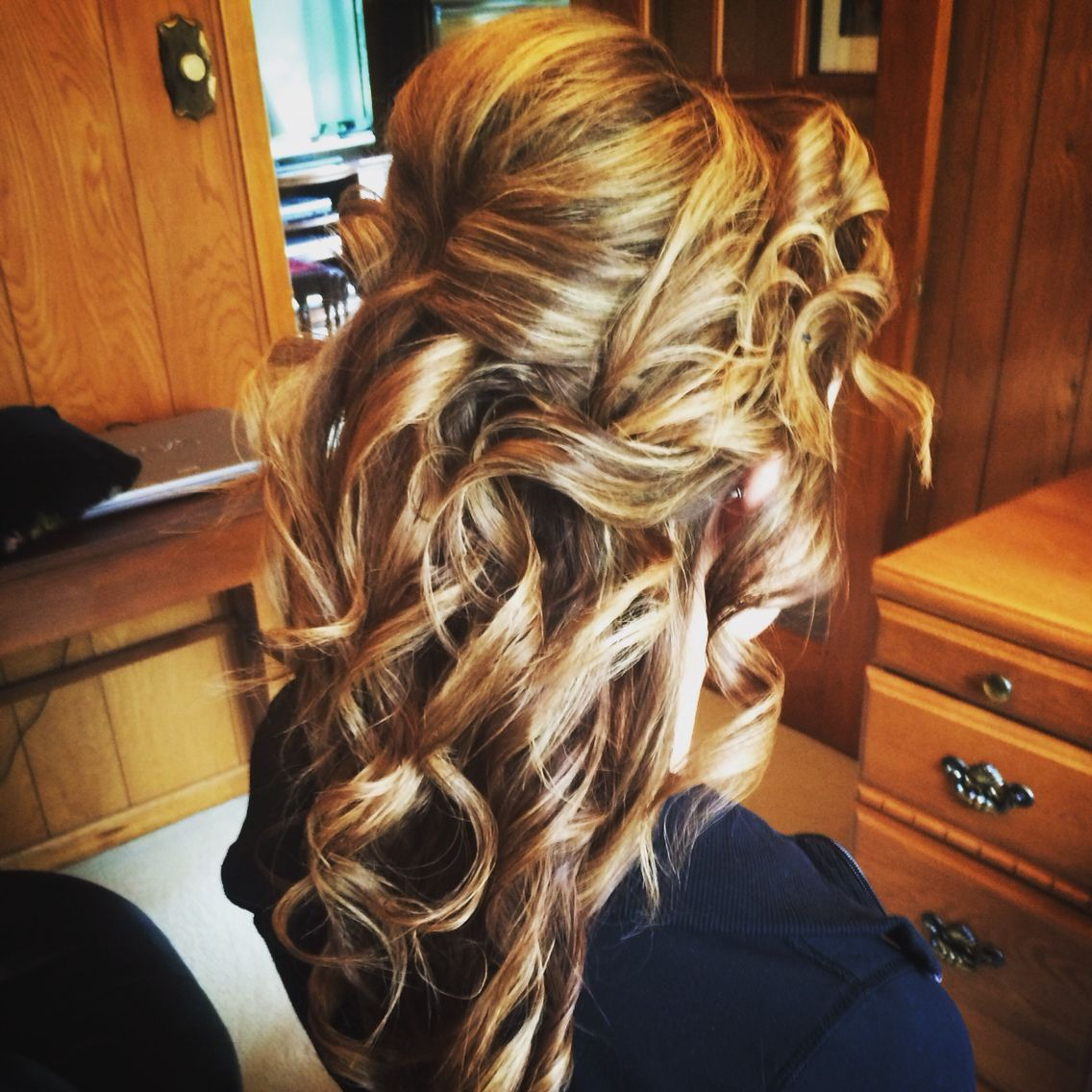 Half up half down bridal hairstyle with loose romantic curls by
