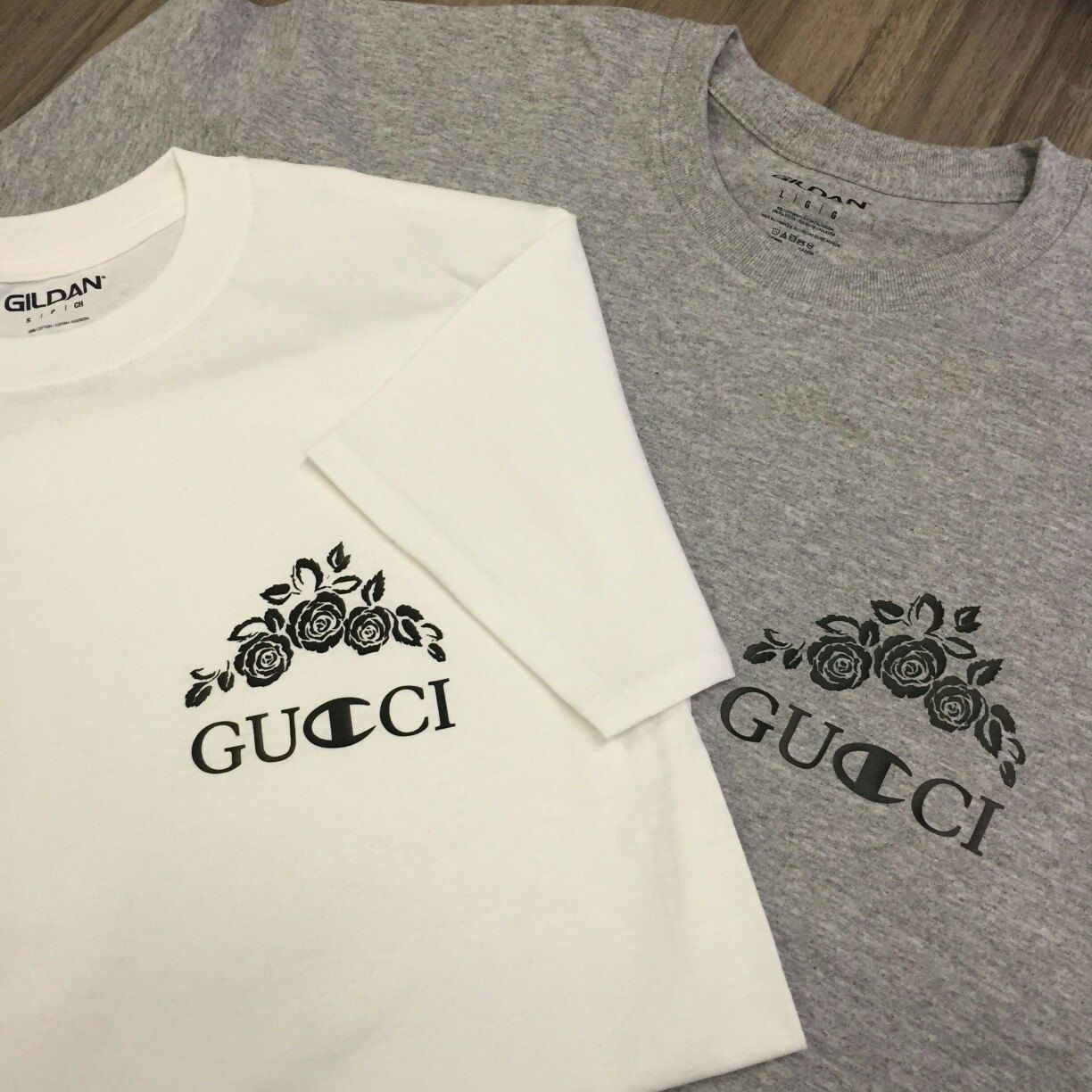42a2906ee50 Floral Gucci X Champion logo t-shirt in grey and white. Also available in  black.  gucci  guccigang