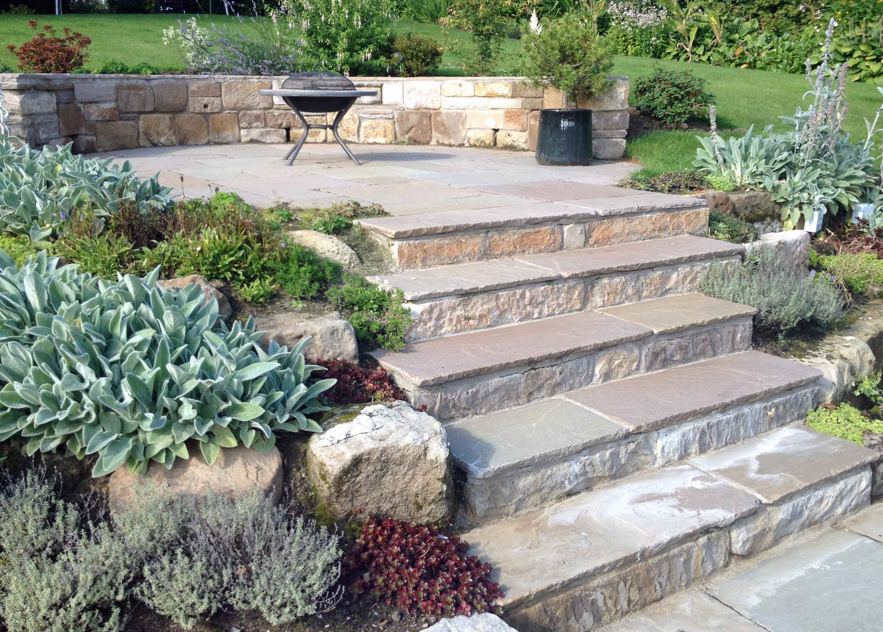 a set of garden steps designed to look old leading up through a