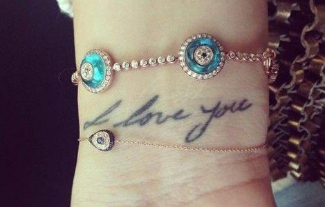 khloe kardashian tattoo of father's handwriting.