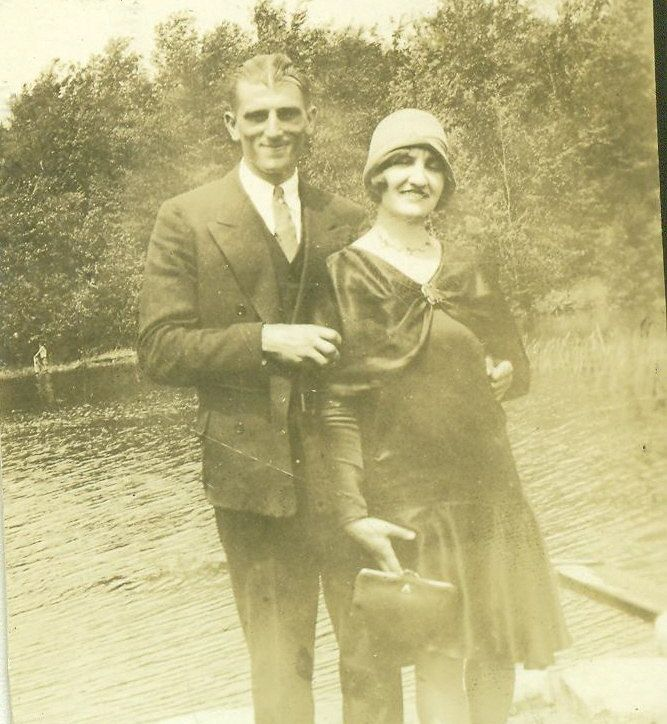 be1244ca763df Pregnant Flapper 1929 Woman Wearing Dress with Baby Bump Happy Husband  Couple 1920s