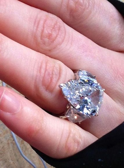d12f0c97a0b4 Which  Just Married  singer wears this 14-carat pear-shaped platinum engagement  ring