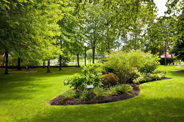 Landscaping Service In Enterprise Al Landscape Irrigation Experts Green Backyard Landscaping Inspiration Green Exterior House Colors