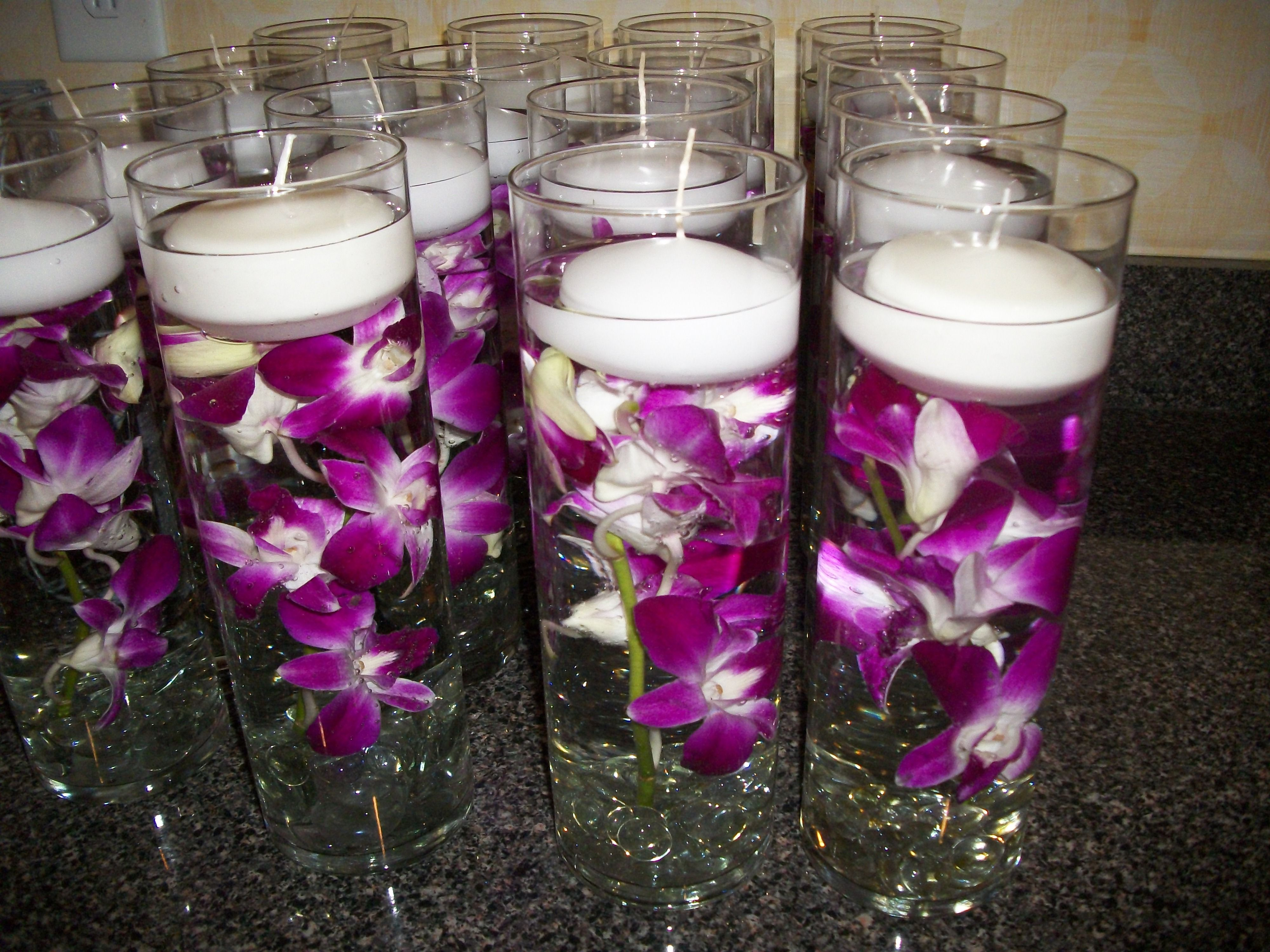 Table deco of purple dendrobium orchids submerged in cylinder table deco of purple dendrobium orchids submerged in cylinder vase w clear marbles on reviewsmspy
