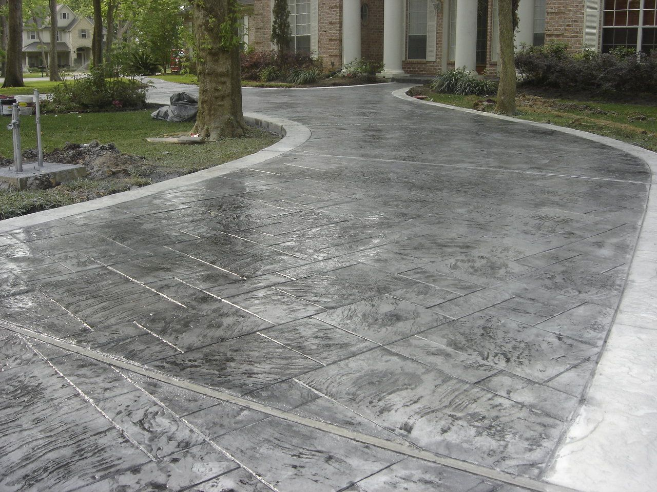 Concrete Driveway Design Ideas stamped and colored decorative concrete drivewaythrough coloring and stamp patterns concrete driveways can enhance the curb appeal of a home Concrete Pavers Driveway Blog Of Js Custom Concrete Patios Masonry Flagstone Denver