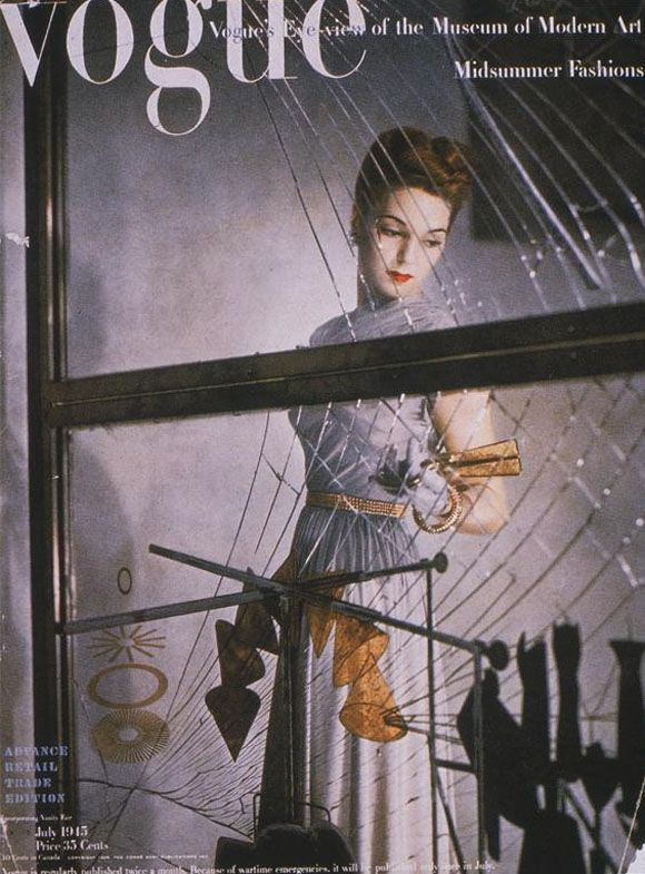 Vogue cover, July 1945 issue. Model with Marcel Duchamp's The Bride Stripped Bare by her Bachelors, Even (The Large Glass), 1915-1923, Philadelphia Museum of Art, Philadelphia, PA, USA. Pinterest.