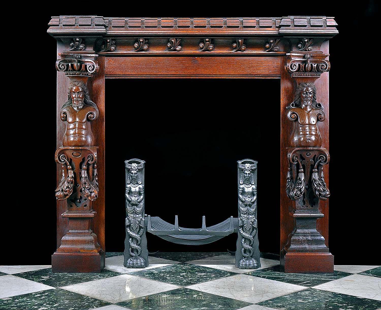 an antique jacobean style oak caryatid fireplace surround
