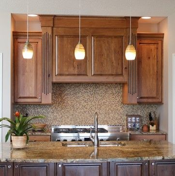 A large wood #hood cabinet is surrounded by #fluted # ...