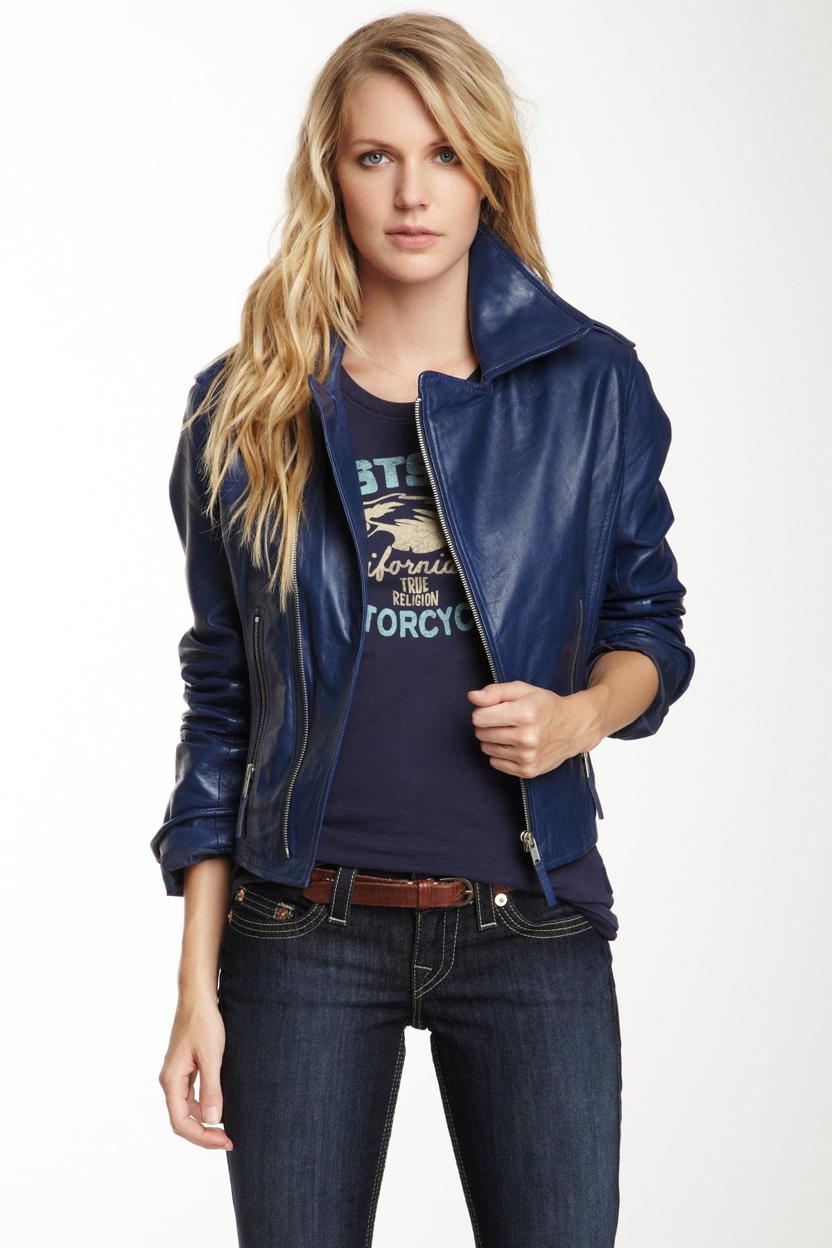 Blue leather moto jacket with graphic tee and dark jeans