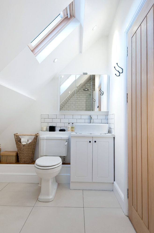 Small Bathroom Under Slanted Ceiling With White Toilet Cabinet Sink Tiling Floor Backsplash Of What Simple Yet