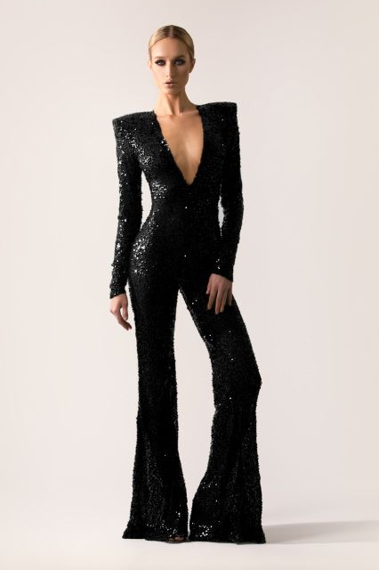 dde3827a9315 Flared leg sequin jumpsuit with strong shoulders   closed back. - Michael  Costello US Size Chart- Terms   Conditions- Shipping- Made to order- Dry  clean ...