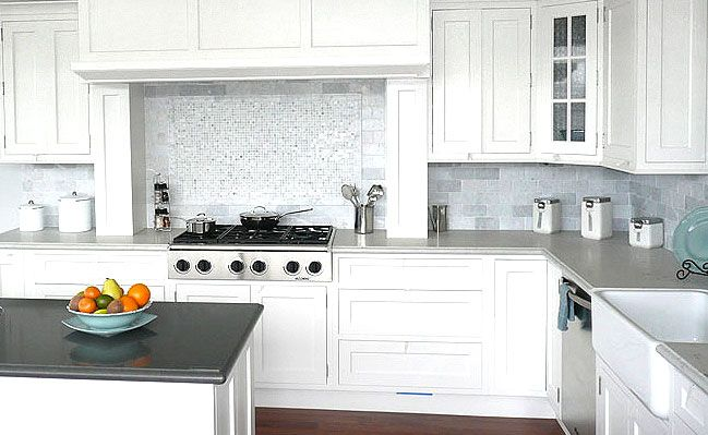 The White Carrara Marble Subway Backsplash Tile Installed In This Kitchen  Brightens The Space, Giving It An Extraordinary Look.