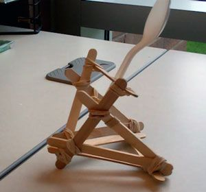 What your Rubber Band Catapult will look like  http://www.mppl.org/kids/crafts/Rubber_Band_Catapult.html  Supplies        10 craft sticks      15 rubber bands      1 plastic spoon
