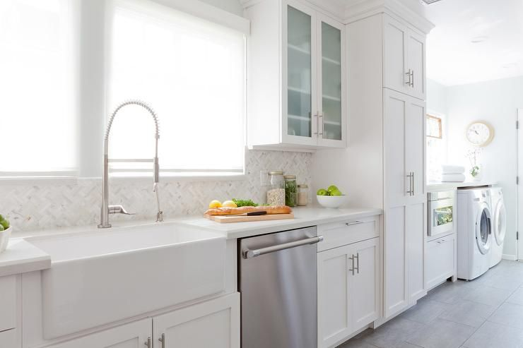Long Kitchen Features White Shaker Cabinets Paired With Off White
