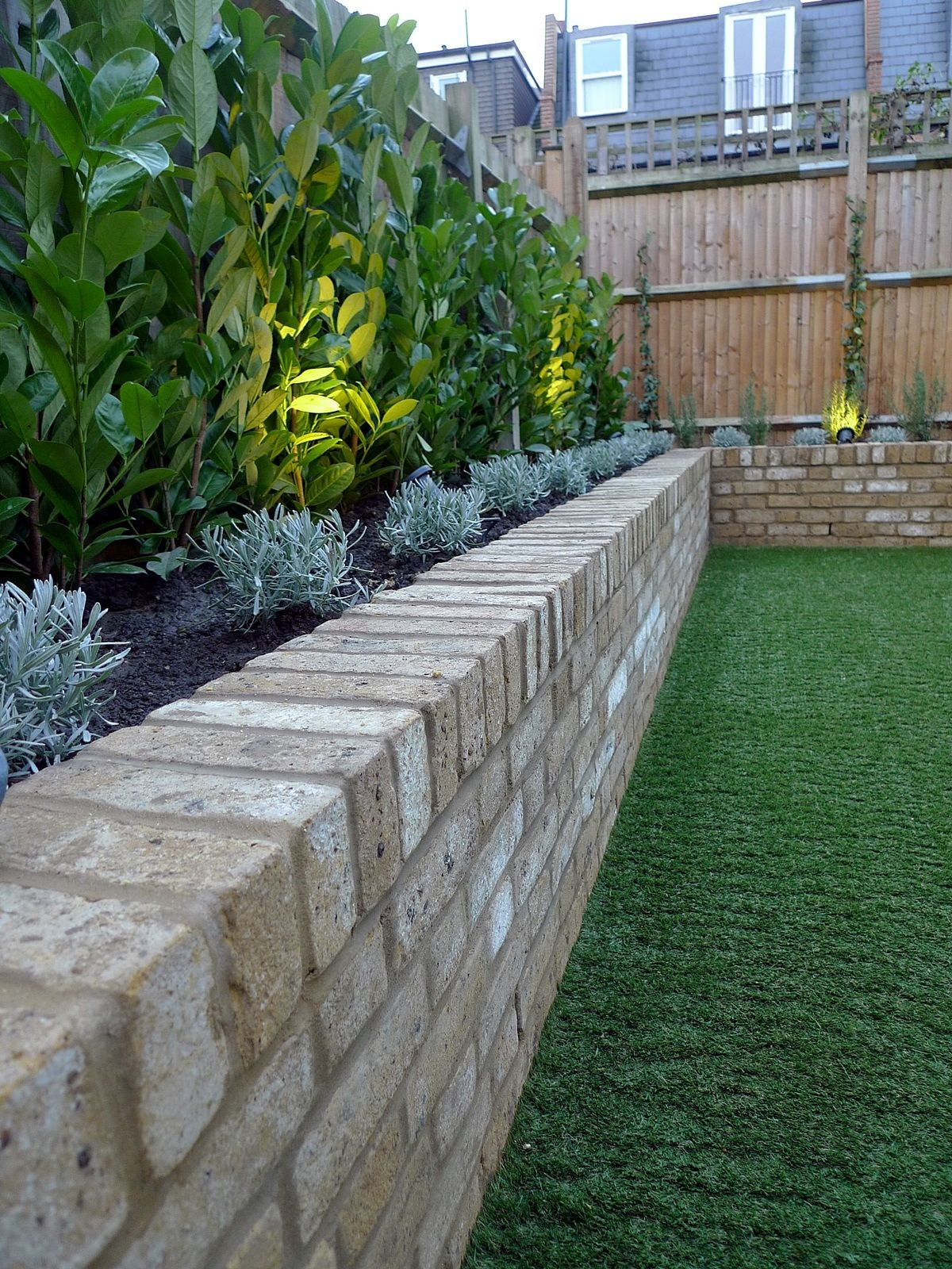 Yellow brick raised bed walls artificial fake easy grass