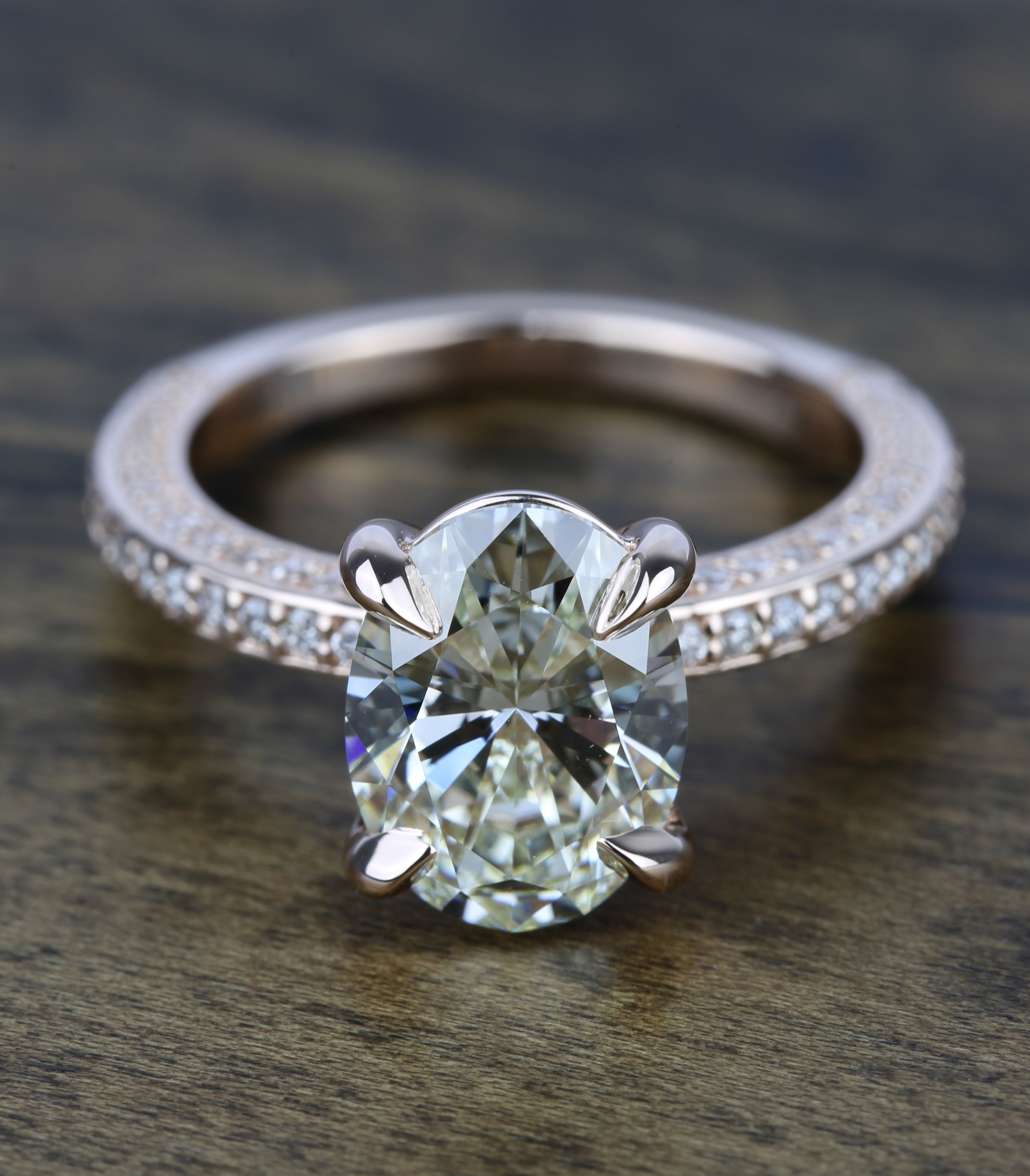 This ring features an oval diamond with a claw prong basket