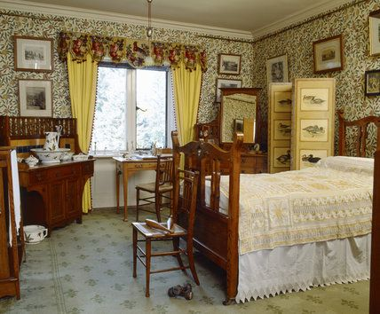 The yellow bedroom with william morris pomegranate or fruit wallpaper at