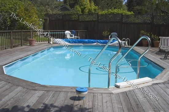 Merveilleux Above Ground Pool Landscape Designs | Above Ground Swimming Pool Surrounded  By Wood Deck