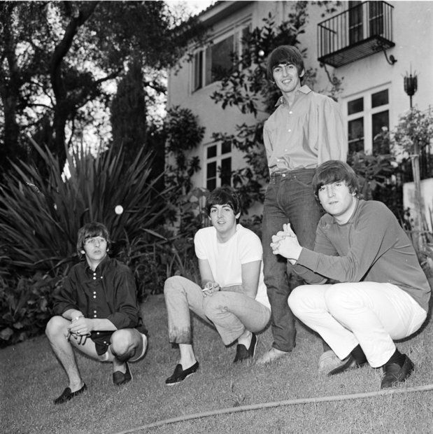 The Beatles relax on the lawn of their rented Bel-Air mansion in August 1964.