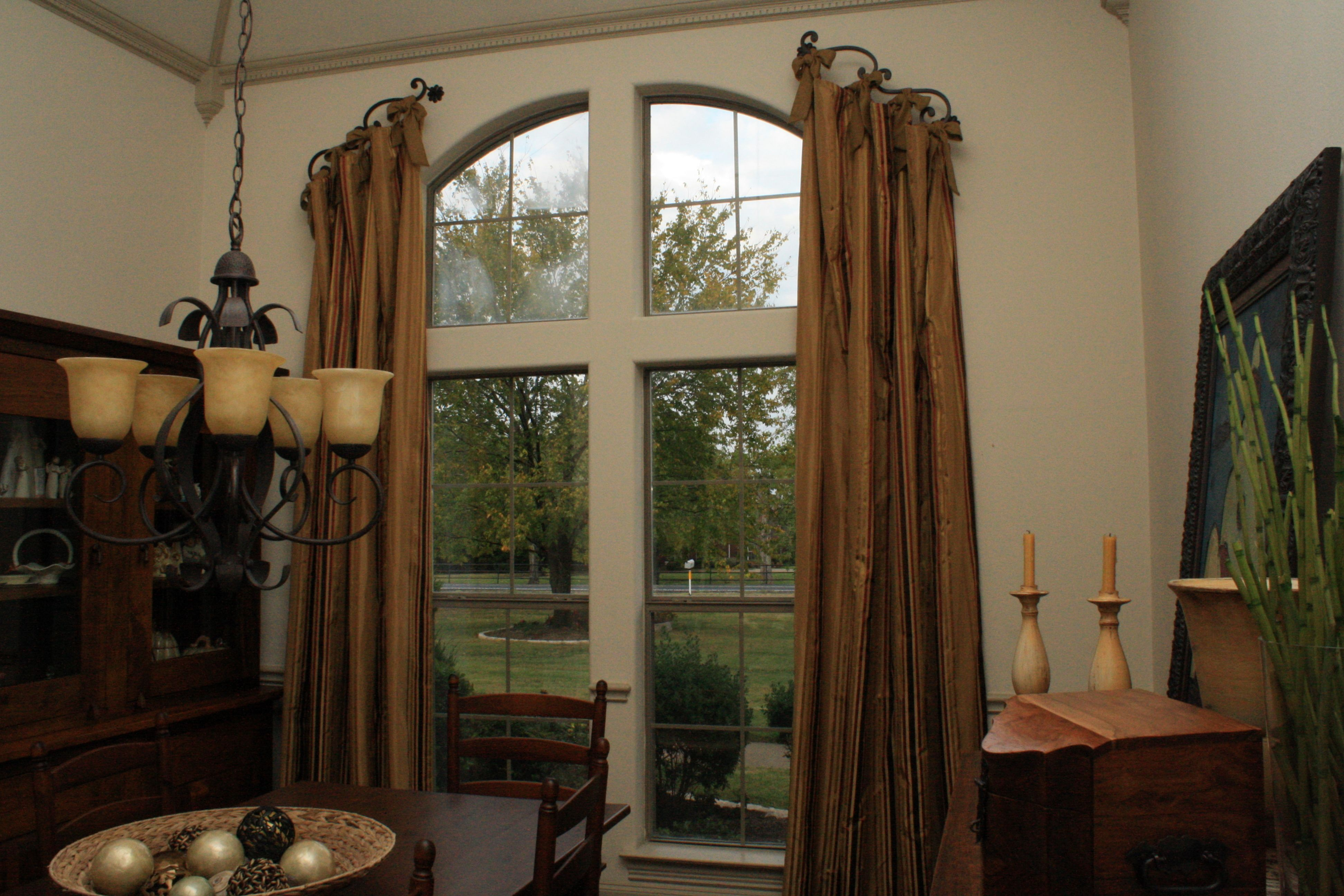 Silk stripe drapery featuring custom carved iron hardware with silk linen sashes.