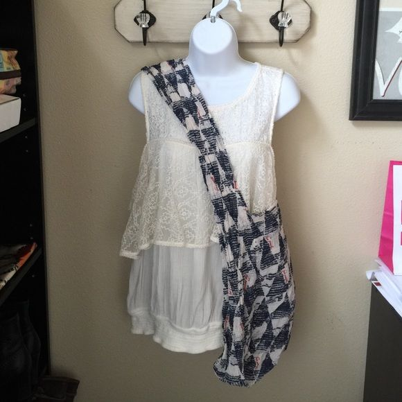 Free People Top and Bag Free people top with peek a boo shoulders. Super cute cream color with lace details. Says M but runs big. Bag is navy accents with red lettering that says free people. Just a linen like Crossbody, light weight bag. Free People Tops
